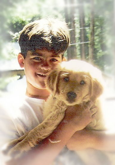 TJ with bear as a pup