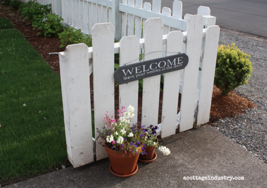 Welcome sign on gate